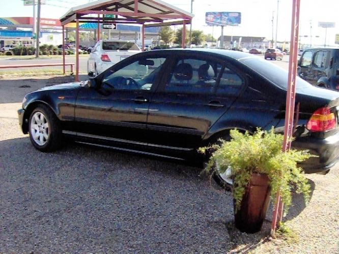 2004 BLACK /Tan Leather BMW 3-Series 325i Sedan (WBAEV33414K) with an 2.5L L6 DOHC 24V engine, located at 2425 Franklin Ave., Waco, TX, 76701, (254) 753-6661, 31.540359, -97.148682 - Photo #0